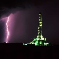 Unit Drilling Rig During Thunderstorm