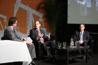 Scott Saxberg, president and chief executive officer of Crescent Point Energy, center, participates in a panel discussion with Gov. Gary Herbert, right, during the 5th annual Energy Development Summit at the Salt Palace Convention Center in Salt Lake City on Wednesday, May 25, 2016 in Salt Lake City.(Chad Zavala, Utah Media Group)