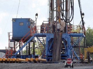 "FILE - In this June 25, 2012 file photo, a crew works on a gas drilling rig at a well site for shale based natural gas in Zelienople, Pa. The Obama administration on Wednesday, June 22, 2016, decried a ruling by a federal judge that blocks rules for hydraulic fracturing, saying the decision prevents regulators from using ""21st-century standards"" to ensure that oil and gas operations are conducted safely on public lands. (Keith Srakocic, File/Associated Press)"