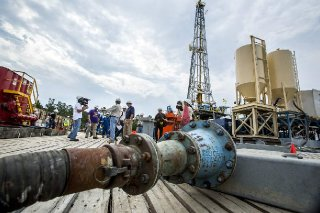 Advocate staff photo by SCOTT THRELKELD -- Reporters tour the drilling operation Monday, June 27, 2017 at Helis' oil-well site near Lakeshore High School in St. Tammany Parish.