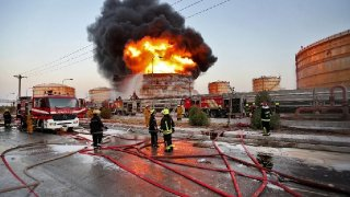 "In this photo released by the semi-official Iranian Isna News Agency, and taken on July 4, 2016, firefighters try to extinguish a blaze at the Bou Ali Sina Petrochemical Complex at the Imam Khomeini port, southwestern Iran. A series of fires at Iranian petrochemical plants and facilities have raised suspicions about hacking potentially playing a role in the blazes. Iran officially insists the six known blazes this summer weren't the result of a cyberattack. However, authorities themselves saying that ""viruses had contaminated"" equipment at several of the affected complexes. (Borna Ghasemi/ISNA via AP)  (The Associated Press)"