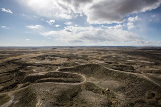 Access roads snake across hillsides and drainages in April 2015 at the Salt Creek oil field in Midwest ( Photo-Star Tribune)