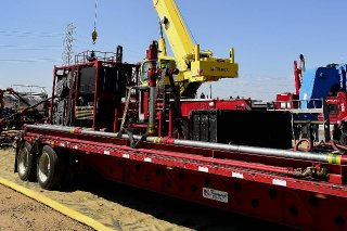 Oil-field services companies such as Halliburton and Schlumberger say they have sharpley reduced their prices in order to help oil companies during the two-year oil swoon, and the prices must come back up in order for an oil revival to take hold. A crane lowers equipment at an Anadarko Petroleum Corp. hydraulic fracturing site north of Dacono, Colo., in this file photo. PHOTO: BLOOMBERG NEWS