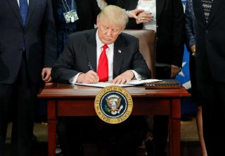 President Donald Trump signs an executive order for border security and immigration enforcement improvements on Jan. 25, 2017, at the Homeland Security Department in Washington. (AP Photo/Pablo Martinez Monsivais)