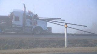 Driver escapes injury in pipe hauling accident