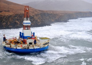 A Royal Dutch Shell drilling rig Kulluk aground off a small island near Kodiak Island in 2013. The Obama administration banned offshore drilling off some portions of the Atlantic and Alaskan coasts. Credit Sara Francis/U.S. Coast Guard, via Associated Press