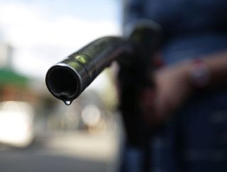 A car being filled up at a gas station in Newcastle, northern England. PHOTO: YUI MOK/ZUMA PRESS