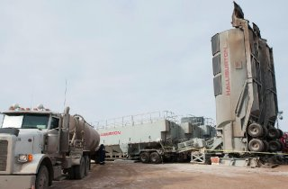Halliburton SandCastle PS-2500 trailers, which store sand for hydraulic fracturing, also known as fracking, stand at a Hess well site near Williston, North Dakota November 12, 2014.