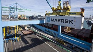 A crane loads a shipping container branded AP MollerMaersk AS onto the freight ship. The company fell victim to a widespread cyberattack on June 27 2017