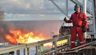 Robert Trice the head of Hurricane Energy spent four months on a drilling rig west of Scotlands Shetland Islands to gather geological information firsthand. Behind him a routine gas flare.