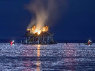 Jefferson Parish La. authorities and others from other parishes respond to an oil rig explosion in Lake Pontchartrain off Kenner La. Oct. 15 2017