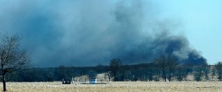Smoke billows from the site of a gas well fire near Quinton Okla. early Monday Jan. 22 2018