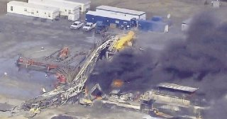Fires burn at an eastern Oklahoma drilling rig near Quinton Okla. Five people workers were killed after a fiery explosion at a drilling rig