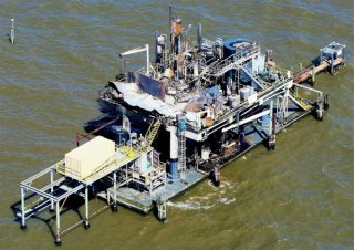 A Clovelly Oil Co. platform is pictured in Lake Pontchartrain north of Kenner after the Oct. 15 2017 explosion and fire that injured seven workers and lead to the death of an eighth.