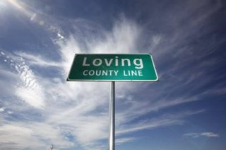 FILE photo shows the county line sign at the eastern line of Loving county on Texas Highway 302.