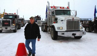 Laurie Gibson of Innisfail gets ready before the convoy to Olds hits the road