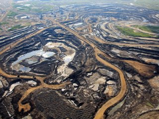 An aerial view of Canadian Natural Resources Limited oilsands mining operation near Fort McKay Alta.