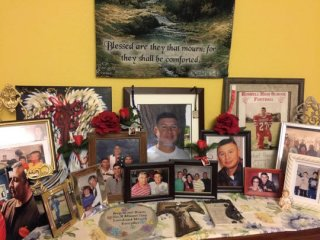 Photos of Michael Ponce who died in an accident on US 285 on February 18 2018 crowd a cabinet in his parents dining room..jpg