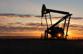 Whiting Petroleum Co. pump jack pulls crude oil from the Bakken region of the Northern Plains.jpg