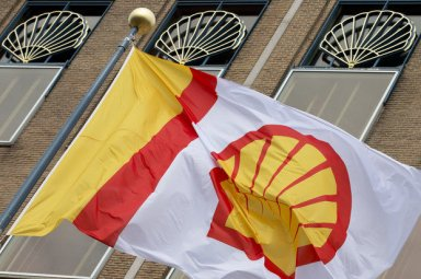In this Monday, April 7, 2014 file photo, a flag bearing the company logo of Royal Dutch Shell, an Anglo-Dutch oil and gas company, flies outside the head office in The Hague, Netherlands. (AP Photo/Peter Dejong) (Peter Dejong)