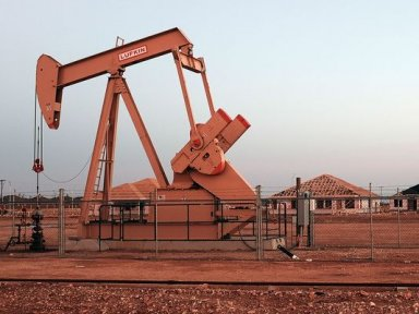 An oil well is viewed near a construction site for homes on February 5, 2015 in Midland, Texas.(Photo: Spencer Platt, Getty Images)