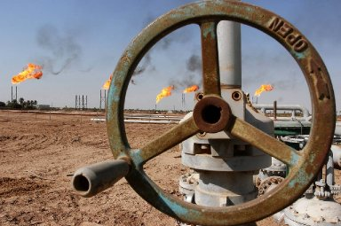 Some OPEC members have talked of a target price for oil of $80 a barrel. Above, Iraq's Nahr Bin Umar oil field.
