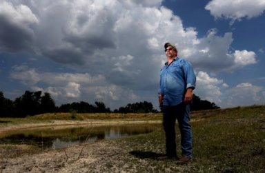 Clifford Wall, 52, who was laid off from his job earlier this year working as a drilling superintendent for Diamond Offshore, at his 69-acre Wall Street Ranch Tuesday, Aug. 11, 2015, in Lampasas, Texas. Wall is a 36-year veteran of the oil industry and has seen many rounds of layoffs in the past, which is why he has been stocking away cash for just this sort of downturn. He lives on the ranch with his wife Roberta and youngest son Wade, 21-years-old.