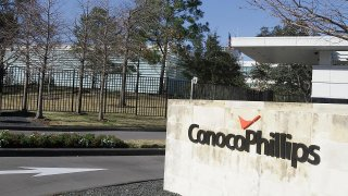 ConocoPhillips said Tuesday it is planning to cut  1,800 employees, or 10 percent of its global workforce, in the next several weeks as it copes with low oil prices