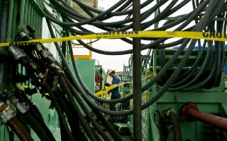 Drillers work at a Colorado shale well owned by Anadarko Petroleum, which expects a tough 2016.