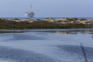An offshore oil rig is seen from the Coal Oil Point Reserve (COPR) west of the UC Santa Barbara campu