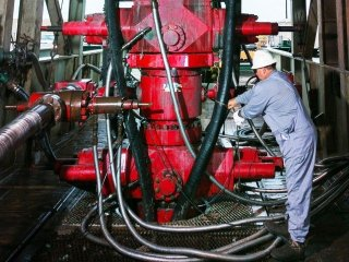A Texas oilfield equipment and services company posted a massive $1.5 billion loss for the fourth quarter of 2015