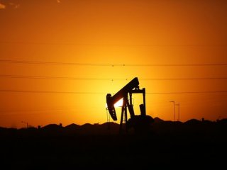 A pumpjack   sits on the outskirts of town at dawn in the Permian Basin oil field on January 21, 2016 in the oil town of Midland, Texas. Despite recent drops in the price of oil, many residents of Andrews, and similar towns across the Permian, are trying to take the long view and stay optimistic. The Dow Jones industrial average plunged 540 points on Wednesday after crude oil plummeted another 7% and crashed below $27 a barrel.