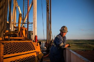 Clint Hulsey pauses while drilling for oil in the Bakken shale formation outside Watford City, North Dakota, in 2013.