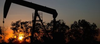 The sun sets behind an oil well in a field near El Tigre, a town within Venezuela's Hugo Chavez oil belt, formally known as the Orinoco Belt. Photo: AP