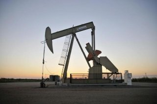 A pump jack operates at a well site leased by Devon Energy Production Company near Guthrie, Oklahoma September 15, 2015.